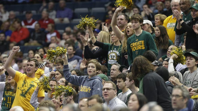 Vermont fans cheer their team on during their first round game of the NCAA Division I Men's Basketball Championship against Purdue Thursday, March 16, 2017 at the BMO Harris Bradley Center in Milwaukee.
