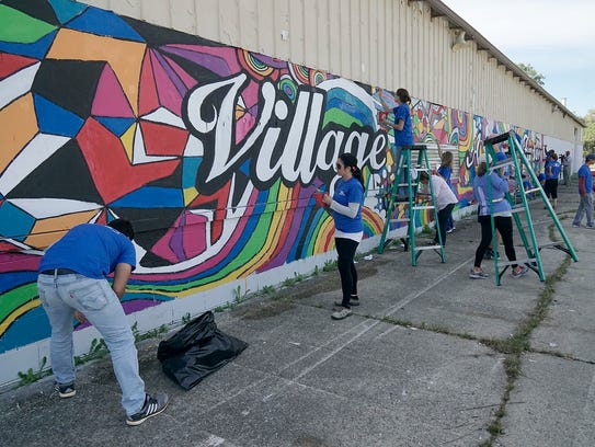 The mural was recently outlined by local students.