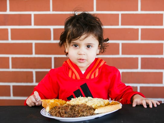 Xavier Sarff, 2, with the pulled brisket meal at Cindy