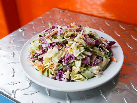 Three-cabbage coleslaw is one of the sides available