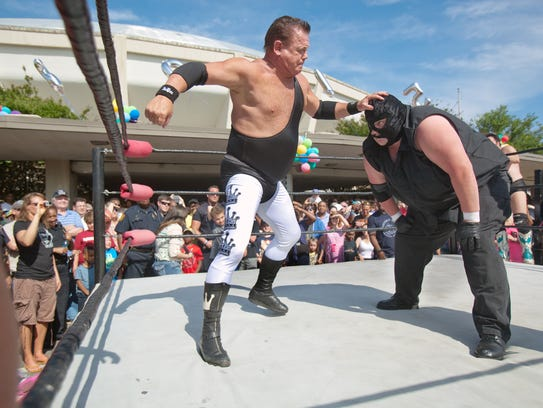 """Mqy 23, 2015 - (left) Jerry """"The King"""" Lawler headlines"""