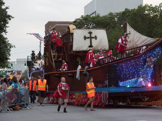 The Fiesta of Five Flags parade rolls through the streets