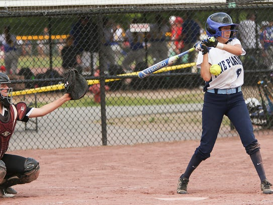 Pine Plains' Tia Fumasoli gets hit by a pitch during
