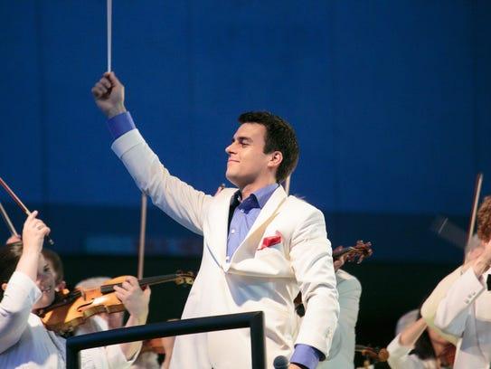RPO music director Ward Stare conducting last year's
