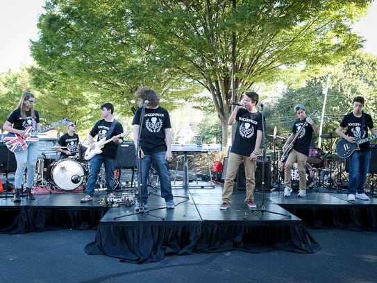 Students of the School of Rock Randolph perform together