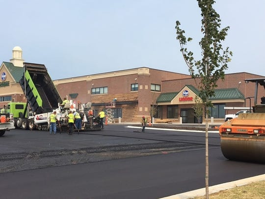 Workers smooth new blacktop at Union's new Kroger Marketplace