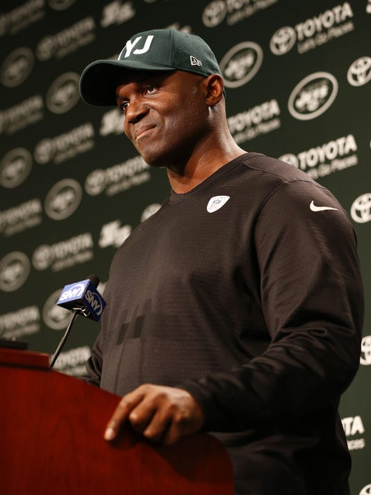 New York Jets head coach Todd Bowles talks to the media after the team cleared out their lockers at the team's NFL football training facility, Monday, Jan. 4, 2016, in Florham Park, N.J. (AP Photo/Rich Schultz)
