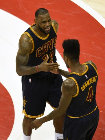 Cleveland Cavaliers forward LeBron James (23) reacts