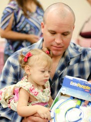 Earl Keopsel, 32, helps his daughter Alessandra Keopsel