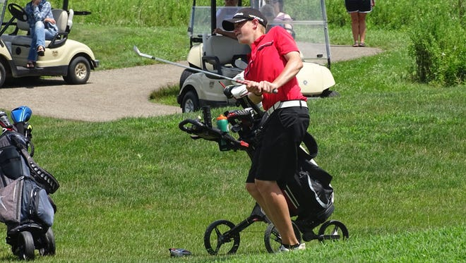 Johnstown freshman Kevyn Neil watches his chip on No. 18 nearly hit the pin Monday at Clover Valley Golf Club during the final round of the Licking County Junior Golf Association season.