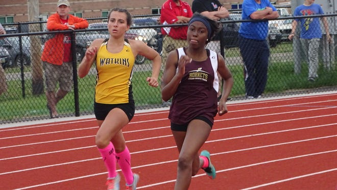 Watkins Memorial senior Makenzie Westbrook and Licking Heights junior Maya Boyce compete in the 400 this past Friday during the Licking County League-Buckeye Division finals at Lakewood.