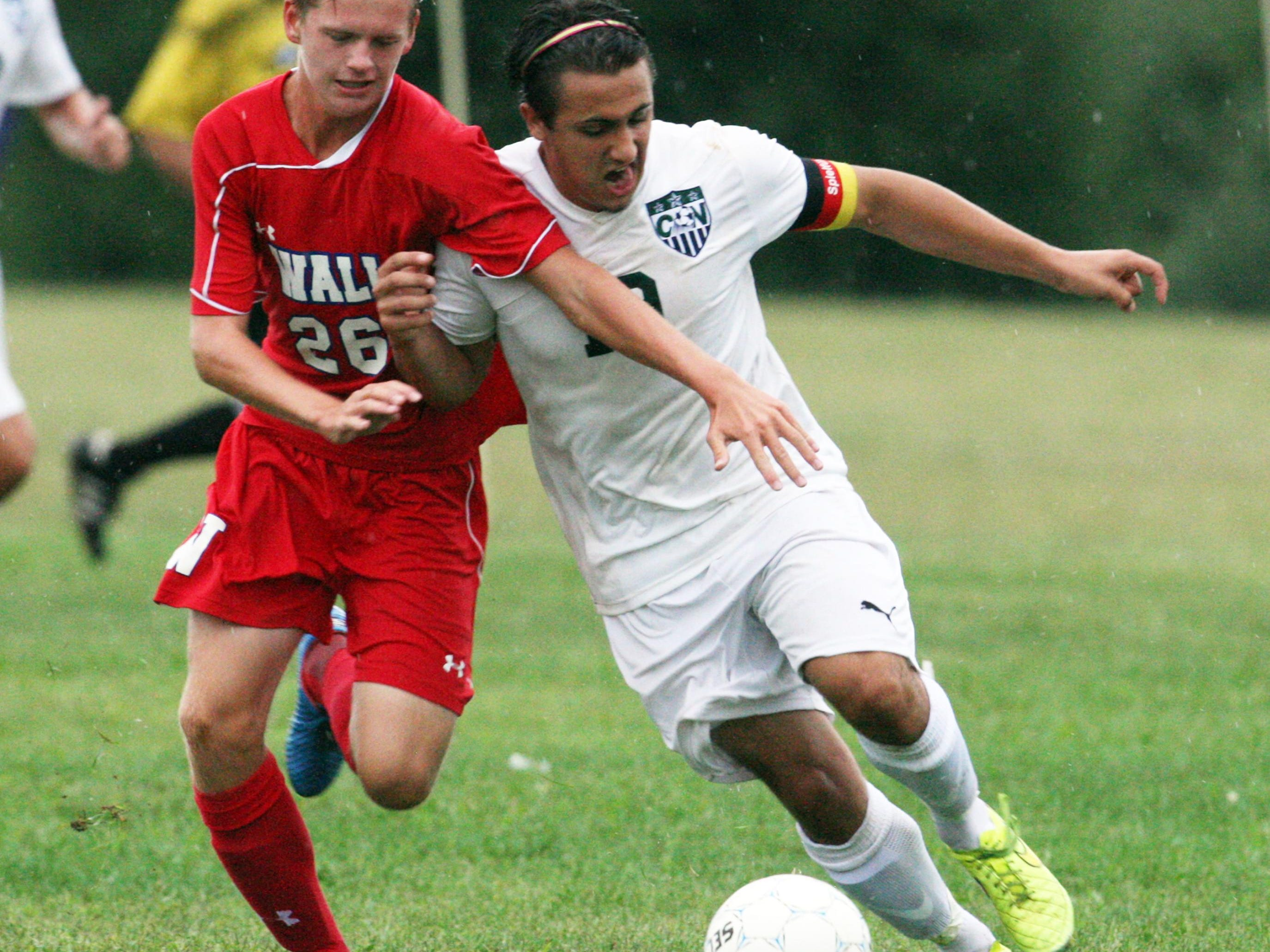 Wall High School 's boys soccer team traveled to Colts Neck to take on Colts Neck High School in a boys varsity soccer game on Thursday September 10,2015. Here Wall's # 26-Jeremy Thompson (left) battles with Colts Neck's # 19 Robert Berdel (right) during the 1st half of play.