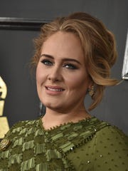 """""""Adele and her partner have separated,"""" the emailed statement said. """"They are committed to raising their son together lovingly. As always they ask for privacy. There will be no further comment."""""""