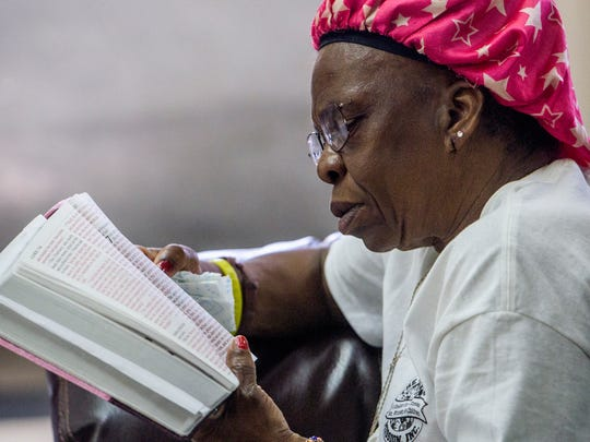 Henrietta Hood reads from the Bible during a Bible stud at the Friendship Mission's women's shelter in Montgomery, Ala. on Thursday October 6, 2016.