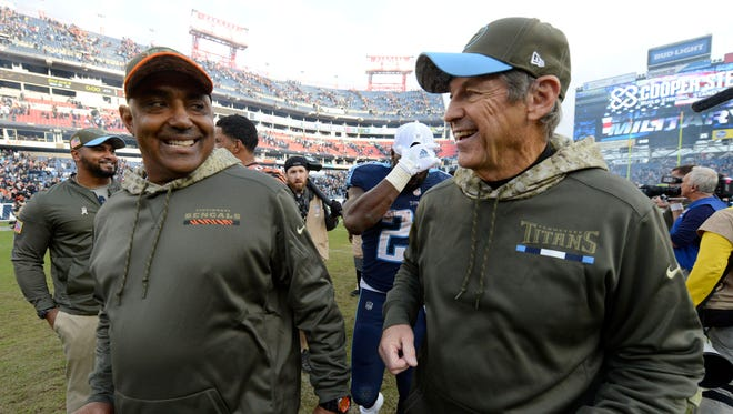 Bengals head coach Marvin Lewis walks off the field with Titans assistant head coach/defensive coordinator Dick LeBeau following the Titans' 24-20 win at Nissan Stadium Sunday, Nov. 12, 2017 in Nashville, Tenn.