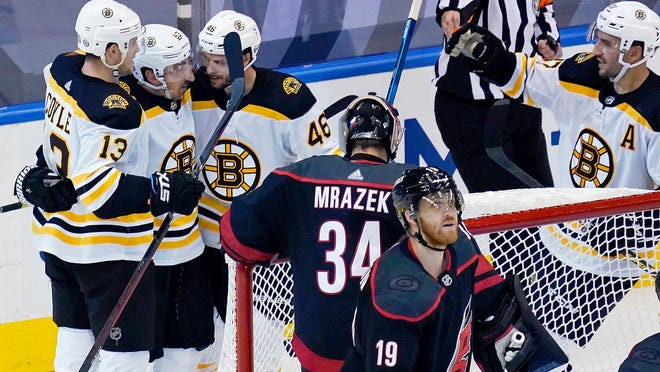 The Bruins' Charlie Coyle, left, celebrates his goal against the  Hurricanes with teammates Brad Marchand, David Krejci (46) and Patrice Bergeron, right, in Game 3 of the first round of the  Stanley Cup playoffs on Saturday. Krejci's presence on the first power-play unit has made up for the loss of David Pastrnak.