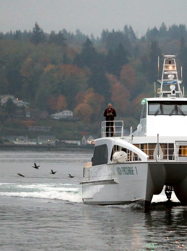 The Kitsap Transit fast ferry Rich Passage 1 arrives for the 8 a.m. sailing to Seattle on Wednesday, November 1, 2017.