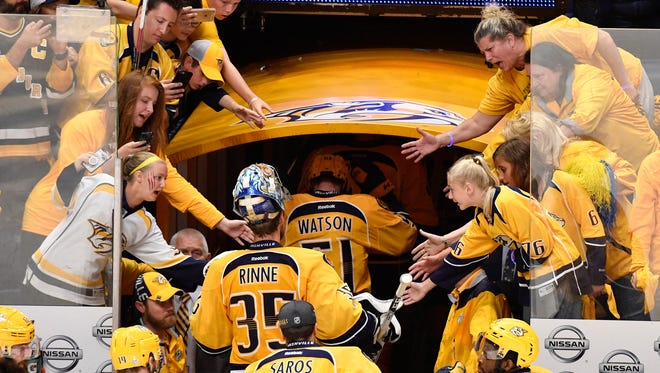Predators fans reach for the players after the team lost the Stanley Cup Final at Bridgestone Arena on Sunday, June 11, 2017.