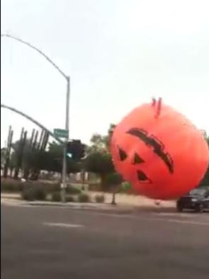 A large, inflatable pumpkin seen on video bouncing