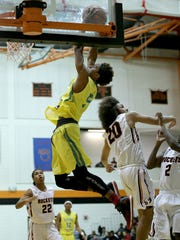 Crispus Attucks' Jamal Harris (5) flies high for a