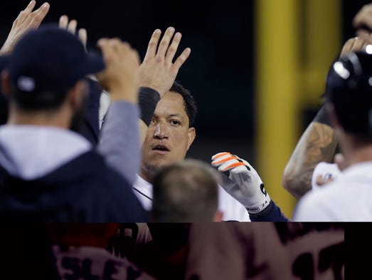 Detroit Tigers' Miguel Cabrera is met at home plate