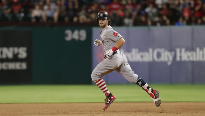 Boston Red Sox left fielder Andrew Benintendi (16) looks back at home after hitting a home run in the eighth inning against the Texas Rangers at Globe Life Park in Arlington on July 4.