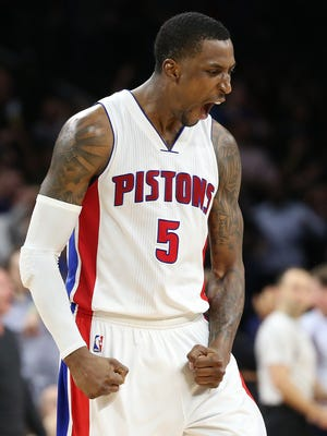 Pistons guard Kentavious Caldwell-Pope (5) reacts after making a dunk during the fourth quarter of the Pistons' 114-108 overtime win over the Hornets Thursday at the Palace.