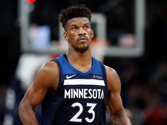 FILE - In this Feb. 11, 2018, file photo, Minnesota Timberwolves forward Jimmy Butler (23)  watches in the third quarter of an NBA basketball game against the Sacramento Kings in Minneapolis. Butler isn't the first NBA star to ask for a trade, nor will he be the last. But it's far from guaranteed that even if he succeeds in forcing Minnesota into making a move he'll wind up in a place he wants. (AP Photo/Andy Clayton-King, File)