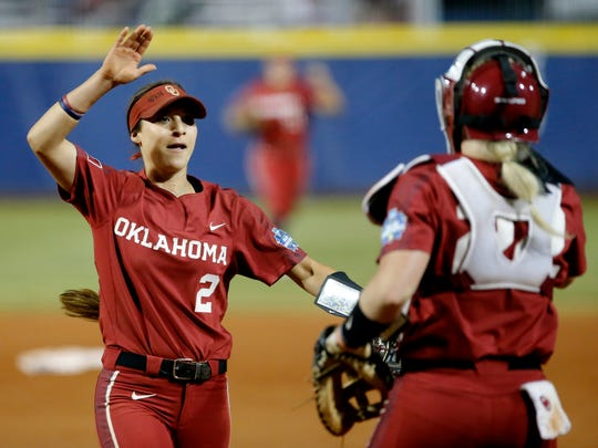 Oklahoma's Sydney Romero (2), one of three finalists for the National Collegiate Player of the Year award this season, celebrates with teammate Lynnsie Elam following a Women's College World Series game in Oklahoma City. Romero will be joining her sister, Sierra, with the USSSA Pride.