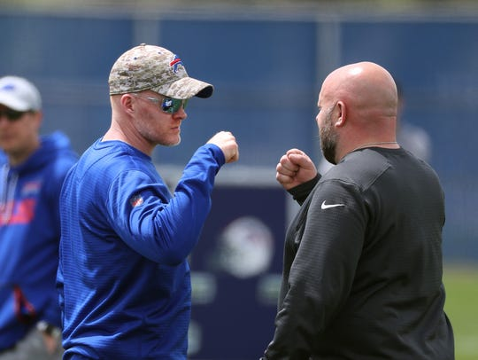 Bills head coach Sean McDermott (L) with his offensive