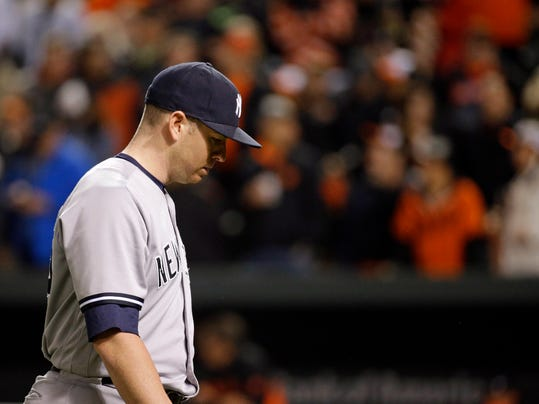 New York Yankees relief pitcher Johnny Barbato walks off the field after being relieved in the tenth inning of a baseball game against the Baltimore Orioles in Baltimore, Thursday, May 5, 2016. Baltimore won 1-0 in ten innings. (AP Photo/Patrick Semansky)