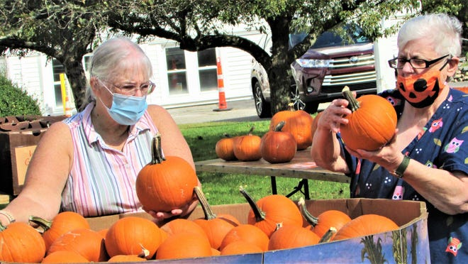 Bourne United Methodist Church volunteers are selling pumpkins again at Sandwich Road this fall with proceeds going to the Friends Food Pantry at Pocasset.    Photo by Paul Gately