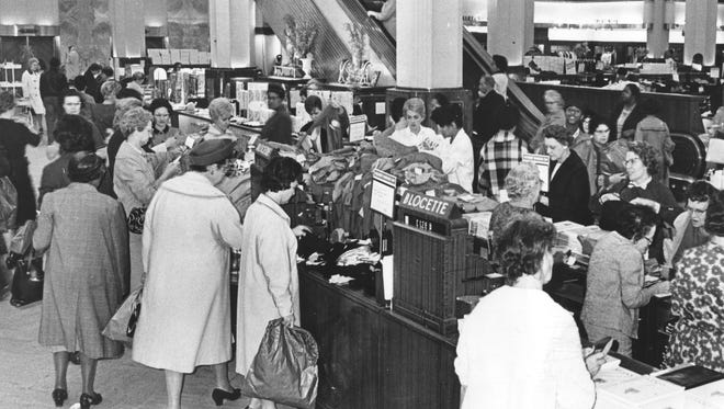 Shoppers swarmed into the William H Block Company store Nov. 8, 1965 to take advantage of the bargains during Hoosier Bargain Day, sponsored by the Indianapolis Merchants Association.  Merchants offered customers deals with coupons that could be entered into a contest to win a 1966 Ford Mustang.