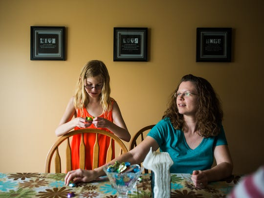 Emma Haines, 11, spends a moment with her mother, Jennifer Haines, at their home Saturday May 28, 2016.