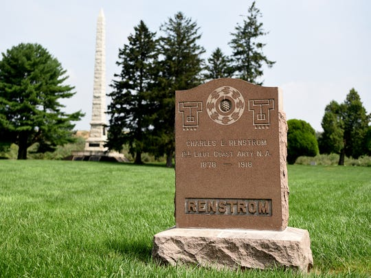 A Confederate Monument, pictured in the distance, was erected by the U.S. government in 1910 to memorialize Confederate soldiers buried in Finn's Point National Cemetery. The monument lists the names of the 2,436 Confederate prisoners of war who died while prisoners of war at Fort Delaware during the Civil War. Also buried in the  cemetery are the 135 Union soldiers who died while serving as guards at the prison camp. A gravestone for 1st Lt. Charles E. Renstrom,  a Union soldier, is seen in the foreground.
