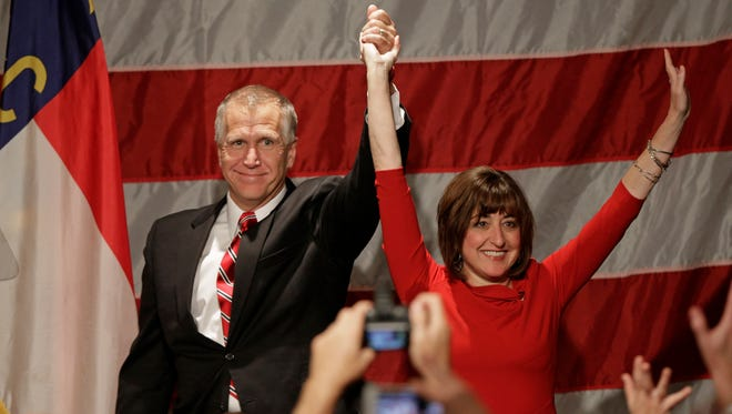 Republican Senate candidate and North Carolina House Speaker Thom Tillis, left, and his wife Susan, right, celebrate with supporters at an election night rally in Charlotte, N.C., early Wednesday, Nov. 5, 2014 after defeating Democratic Sen. Kay Hagan.
