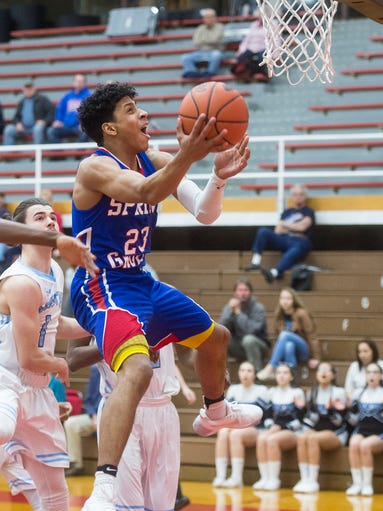 Spring Grove's Eli Brooks (23) scores against East