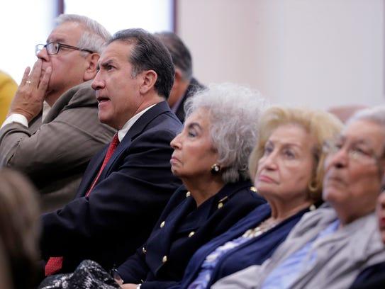 Committee members listen as District Attorney Jaime