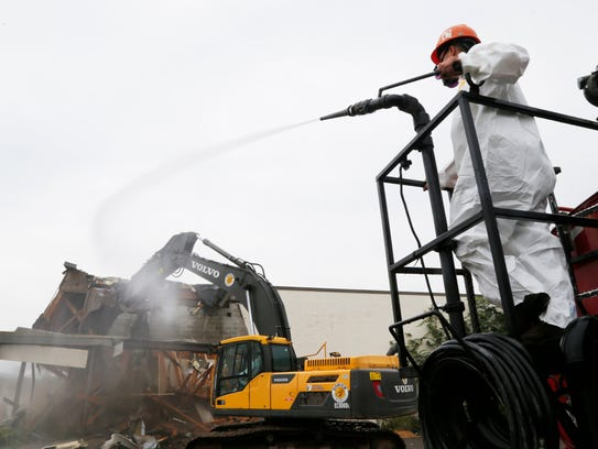 A crew works on demolition of the former Big Lots at