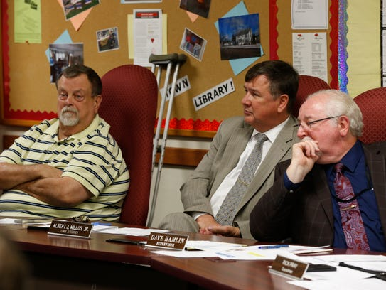 From left, Town of Fenton council member Mike Husar,