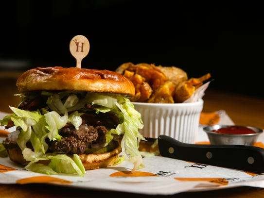 The all-American burger with bacon, cheddar cheese, bacon, iceberg lettuce, pickles, red onion, ketchup and house aioli.
