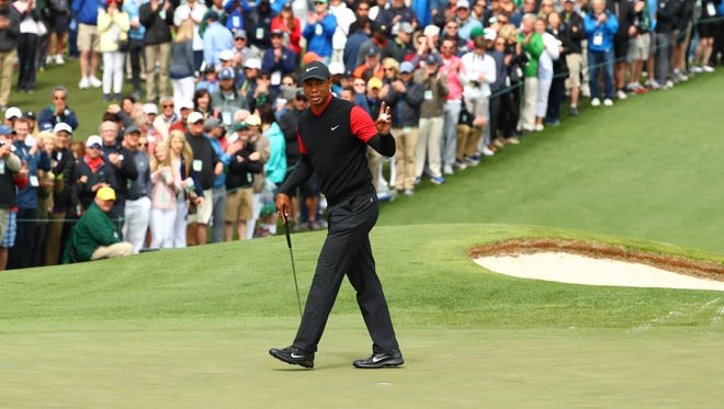 Tiger Woods after making a putt on the second green during the final round of the Masters.