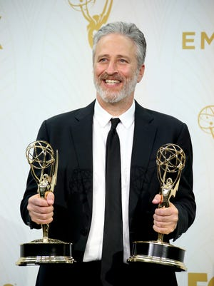 LOS ANGELES, CA - SEPTEMBER 20: Jon Stewart poses with his awards for Outstanding Directing and Writing For A Variety Series in the photo room at the 67th Annual Primetime Emmy Awards at the Microsoft Theater on September 20, 2015 in Los Angeles, California.
