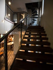 The industrial steel and wood open staircase leading to the upper level.