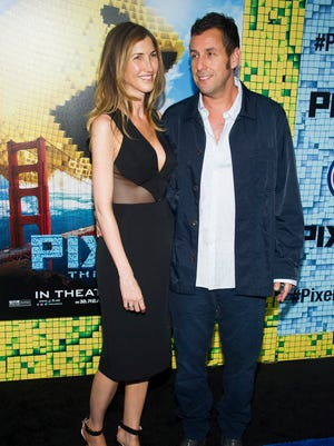"""Adam Sandler, right, and Jackie Sandler attend the world premiere of """"Pixels"""" at Regal E-Walk on Saturday, July 18, 2015, in New York."""