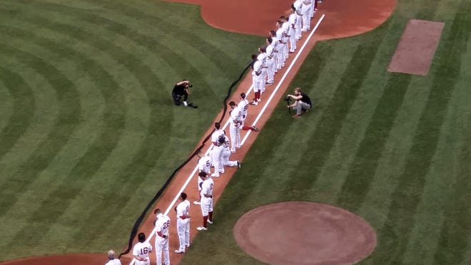 Several Red Sox players and staff members, including Jackie Bradley Jr. and Alex Verdugo, took a knee for Friday's national anthem.