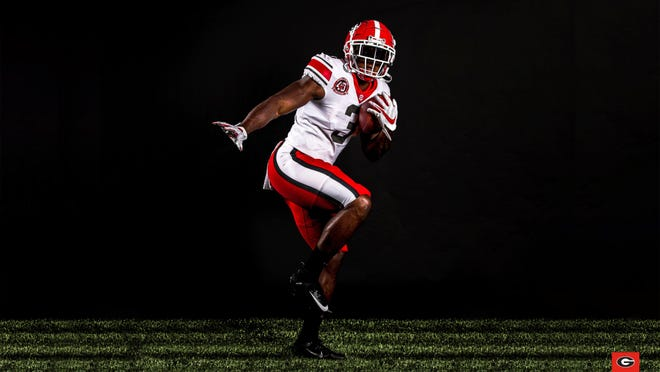 Georgia showed off 1980 throwback uniforms on Twitter on Thursday.