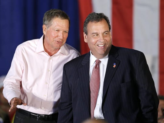 This Sept. 29, 2014 photo shows Ohio Gov. John Kasich, left, joking with New Jersey Gov. Chris Christie at a campaign rally in Independence, Ohio. In an interview with NBC's Meet the Press on Sunday, Jan. 3, 2016, Kasich criticized Christie's economic record as New Jersey governor. (AP Photo/Mark Duncan)