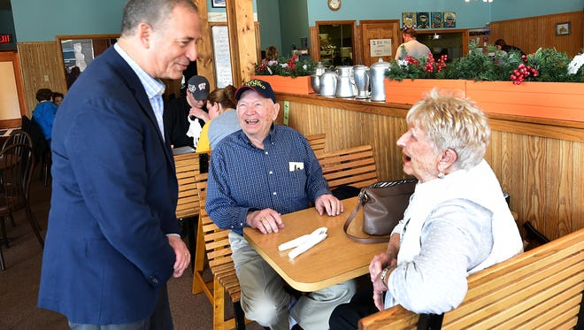 U.S. Senate candidate Russ Feingold shares a laugh with Arvid and Jan Alvin of Sturgeon Bay on Sunday morning at The Corner Cafe, 113 N. Third Ave., Sturgeon Bay. Feingold is touring 72 counties to meet and listen to concerns of community and business owners.