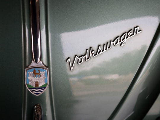 The emblem on a 1958 Volkswagen Beetle ragtop at Classic